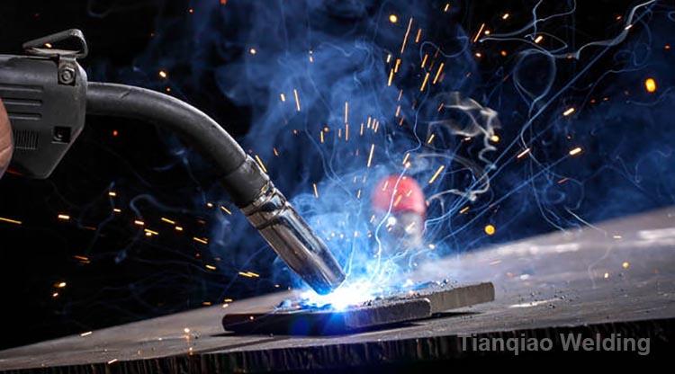 Worker welding theiron